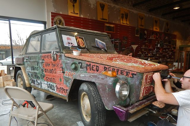 The redesigned Beanmobile is being decorated by the Krewe of Red Beans at the Southern Food and Beverage Museum