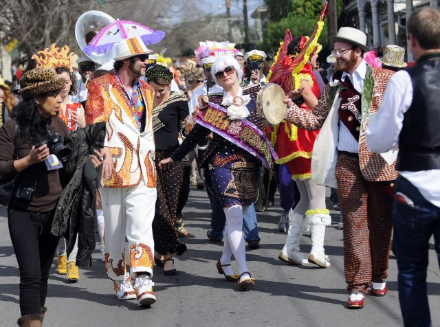 Devin Meyers leads the Red Beans Parade on Lundi Gras