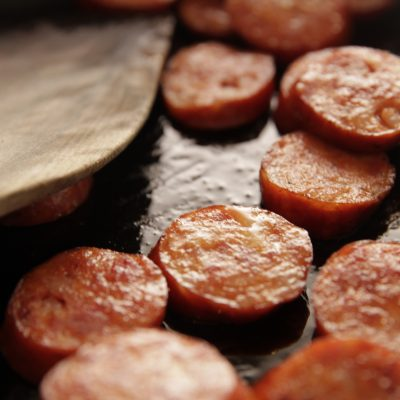 Sliced Andouille Cooking Up Close