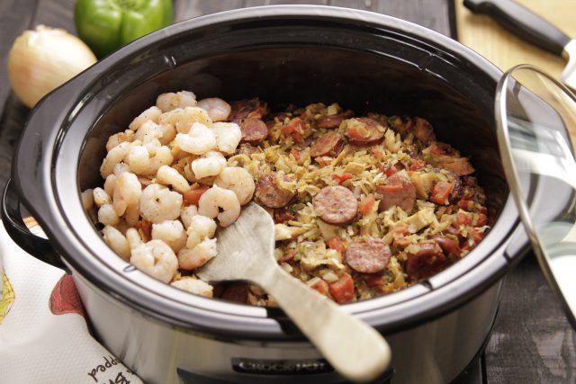 Adding shrimp to Camellia Jambalaya Dinner Mix in a slow cooker