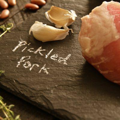Pickled Pork on Black Cutting Board