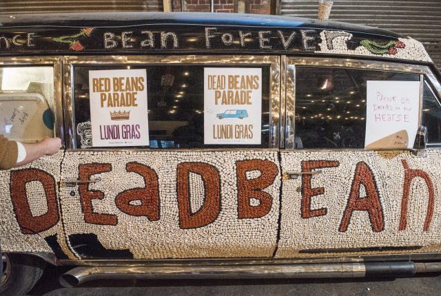Red Beans Krewe working on beaning a hearse for the Dead Beans parade on January 31, 2019.