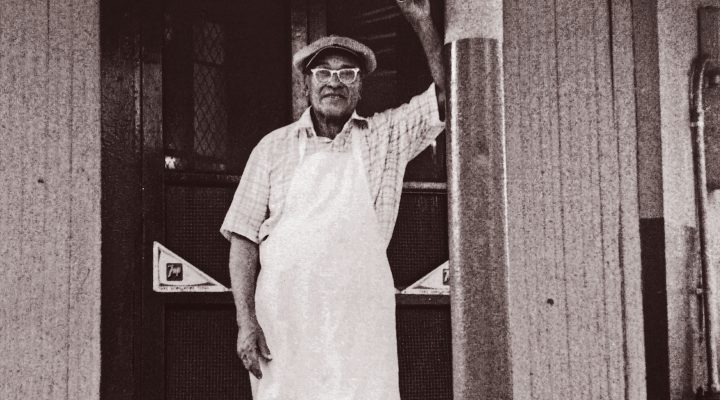 Buster Holmes in front of his restaurant