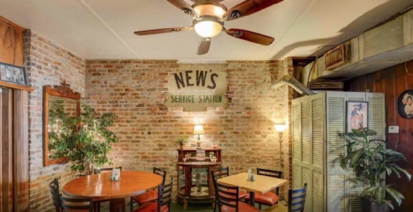 The original gas station signage is still visible in the restaurant's dining room.