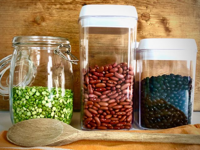 Dried lima beans, red beans and black beans in sealed jars